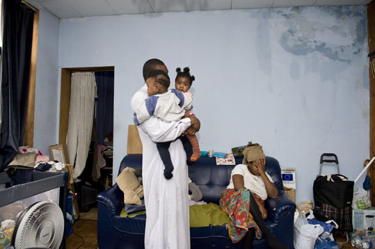 Adedayo Folowosele and Florence Benga from Nigeria live with their three children in an old humid house in Molenbeek. They wait regularisation and can't afford a decent house. (Nick Hannes)